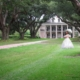 Oak Alley Plantation with woman in period dress